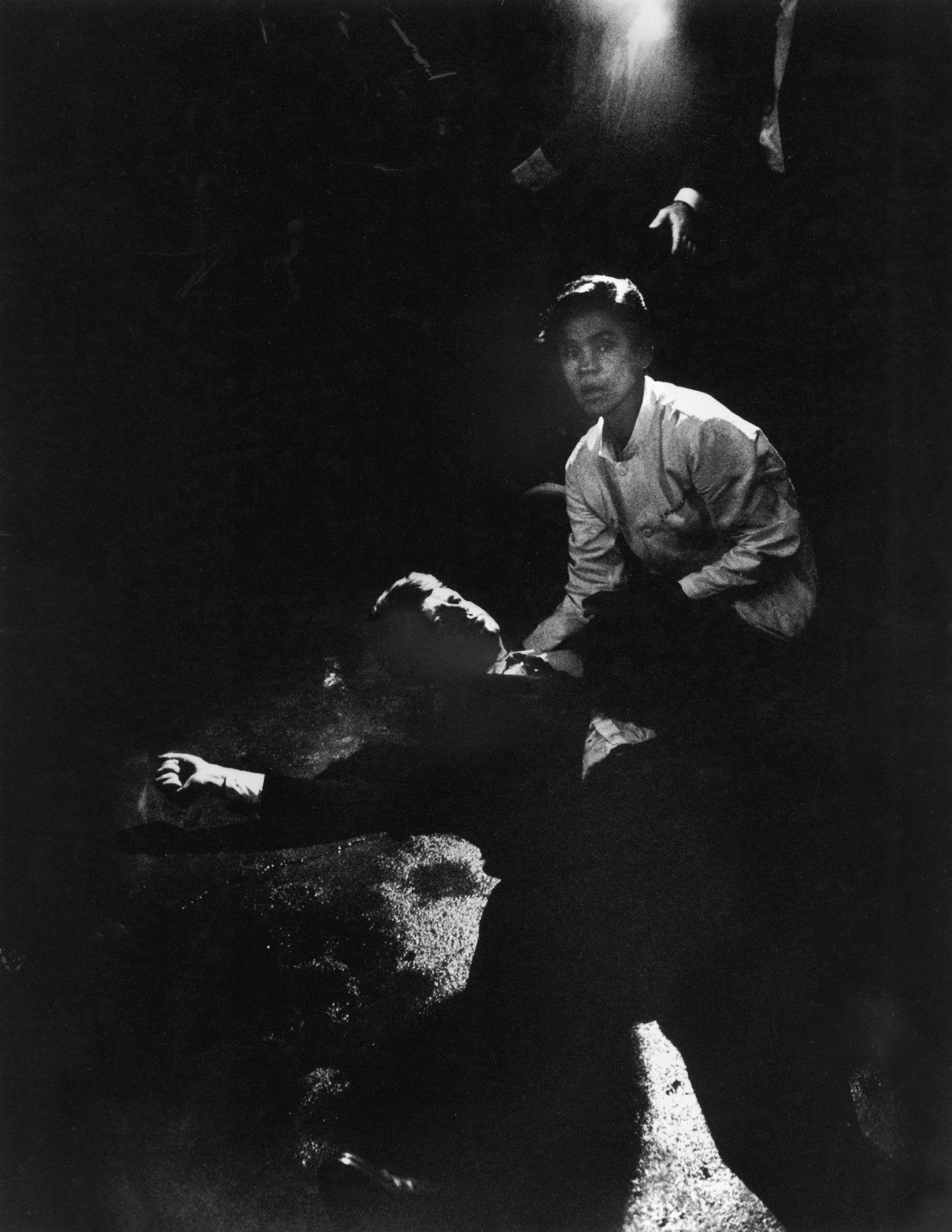 Sen. Robert Kennedy sprawled semiconscious in his