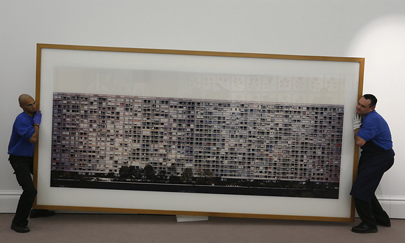 Sothebys-employees-hold-Gurskys-artwork-Paris-Montparnasse-at-Sothebys-auction-house-in-London_1382086925887576