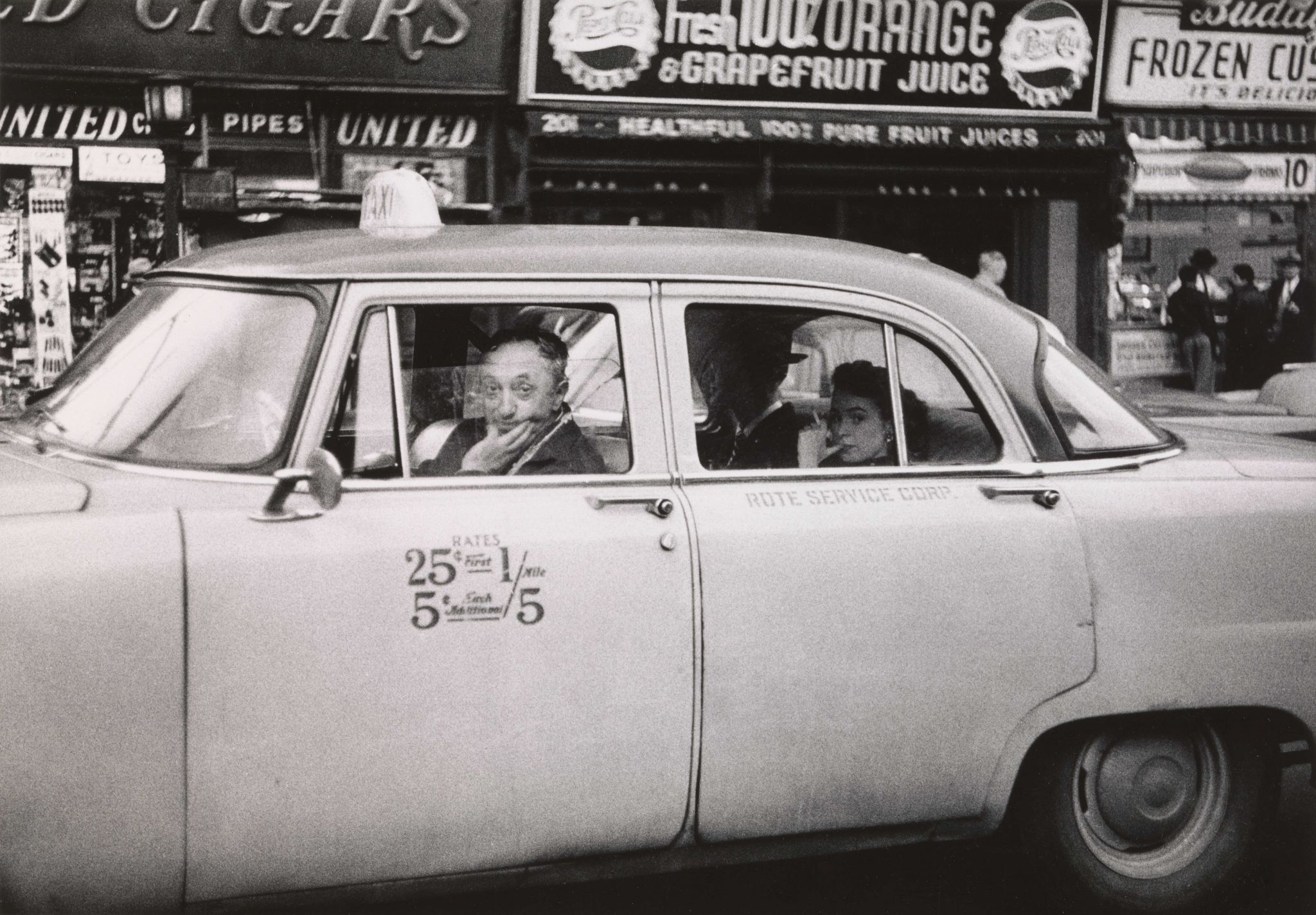 6. Taxicab driver at the wheel with two passengers, N.Y.C. 1956